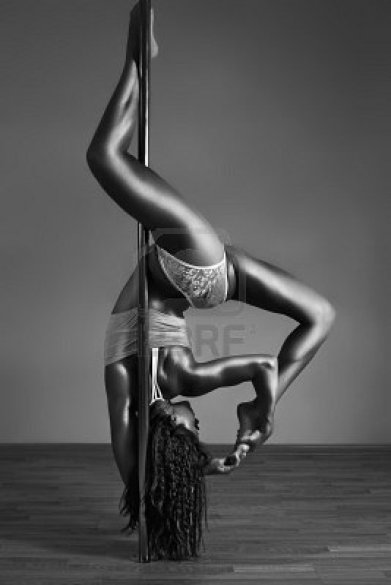 8278262-young-sexy-pole-dance-woman-contrast-black-and-white-colors